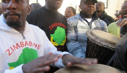 Zimbabweans protest on The Strand - and get in the way of Kenyans' beer and ugali.