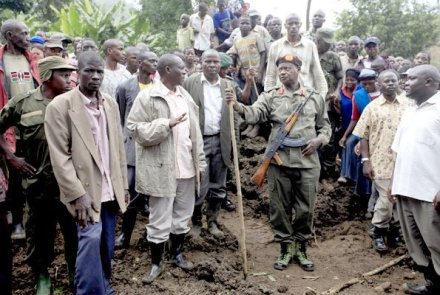 Half-civilian president: In crisis or faced with opposition challenge,  Museveni always jumps into his military fatigues and picks up a rifle. Here he visited landslide victims in Mbale in full combat garb and AK47.