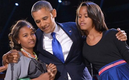 President Obama and his daughters. They told him about Kony 2012.
